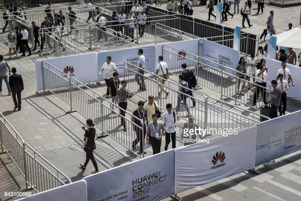 Visitors arrive the Huawei Connect 2017 conference in Shanghai China on Tuesday Sept 5 2017 Huawei Technologies Co aims to establish a union of...
