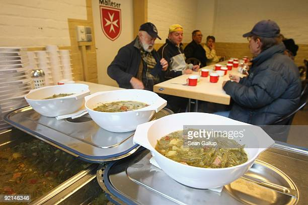 Visitors arrive to eat hot soup at a soup kitchen of the Malteser charity part of the Order of Malta Worldwide Relief on October 21 2009 in Berlin...