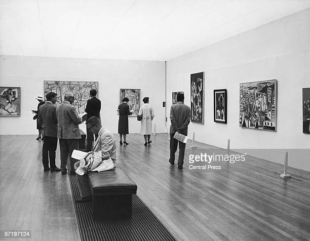 Visitors at a private viewing of the new Picasso exhibition at the Tate Gallery 5th July 1960 The exhibition opened to the public the next day
