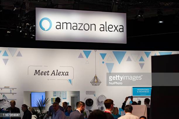 Visitors at Amazon Alexa boot during the international electronics and innovation fair IFA in Berlin on September 10 2019