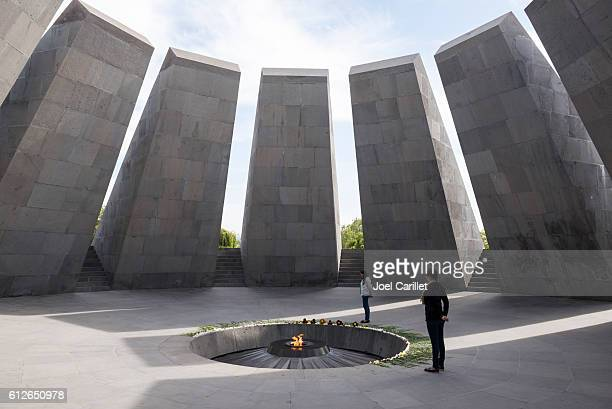 visitors at armenian genocide memorial in yerevan - armenian genocide stock pictures, royalty-free photos & images