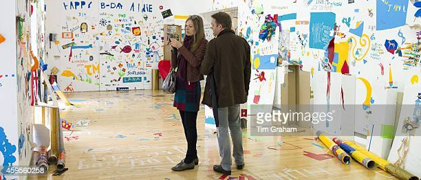 Visitors at Atelier Public 2 exhibition of free expression artworks by members of the public on display in Gallery of Modern Art GoMA Royal Exchange...