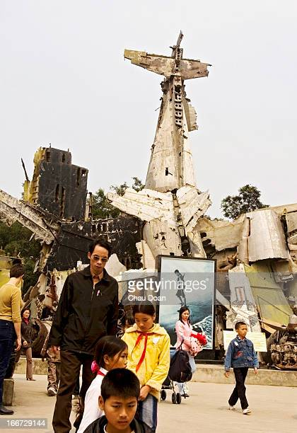 Visitors at Hanoi Army Museum in front of wreckages of French and American aircrafts, shot down by Vietnamese troops in the Dien Bien Phu campaign...