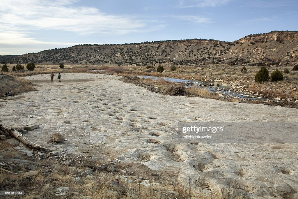 Visitors at Jurassic sauropod dinosaur tracksite Purgatoire River Colorado : Stock Photo