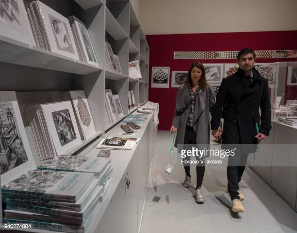 Visitors at Museu de Arte Popular shop with merchandise related to Dutch artist Maurits Cornelis Escher exhibition on March 30 2018 in Lisbon...