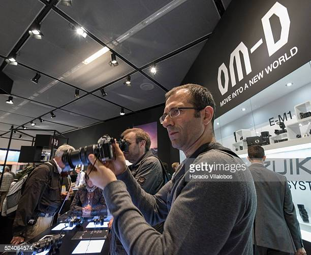Visitors at Olympus stand in Photokina 2014 in Cologne Germany 18 September 2014 Photokina the world's leading imaging fair brings together the...
