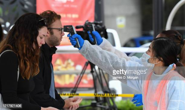 Visitors at Sydney Fish Market have their temperature checked before being allowed access on April 10 2020 in Sydney Australia With strict social...