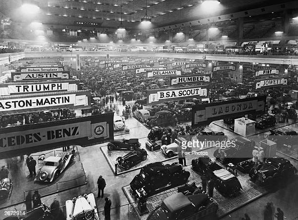 Visitors at the 1937 Motor Show at Earls Court London the first time at the venue