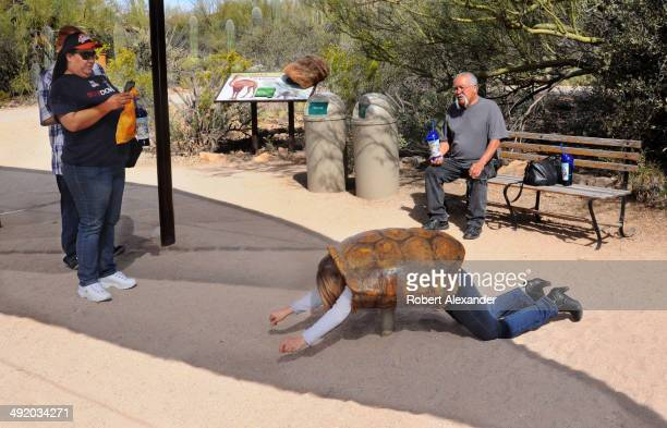 Visitors at the ArizonaSonora Desert Museum in Saguaro National Park near Tucson Arizona enjoy a photo opportunity at the outdoor museum's desert...