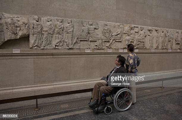 Visitors at the British Museum view the controversial 'Elgin Marbles' sculptures as seen in this 2009 London United Kingdom cityscape photo