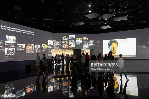 Visitors at the Canon booth at the 2016 Photokina trade fair on September 24 2016 in Cologne Germany Photokina is the world's largest trade fair for...