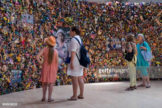 Visitors at the exhibition by German photographer Michael Wolf at the Rencontres d'Arles famous annual photography festival in the town of Arles in...