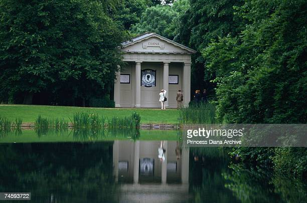 Visitors at the grave and memorial to Princess Diana on an island in a lake at her family home at Althorp Park Northamptonshire July 1999