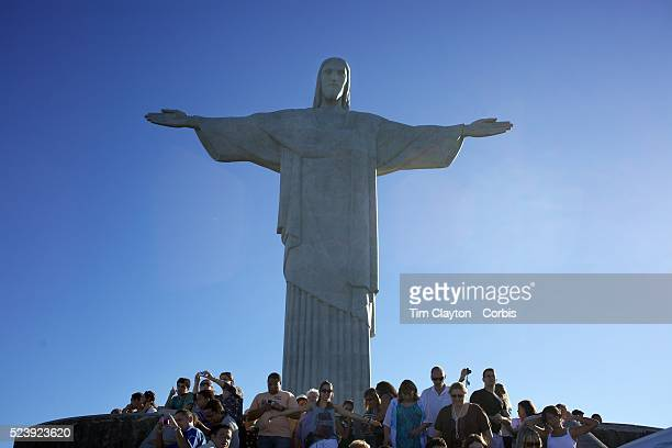 Visitors at the iconic Cristo Redentor Christ the Redeemer statue sits atop the mountain Corcovado The Christ statue was voted one of the seven...