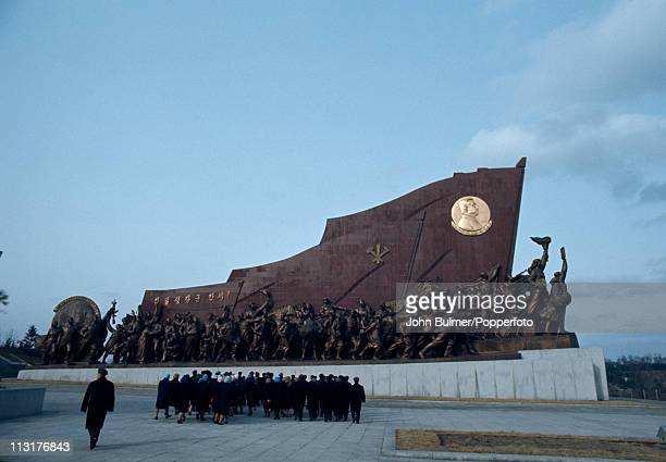 Visitors at the Mansudae Grand Monument which depicts the North Korean revolutionary struggle Pyongyang North Korea February 1973