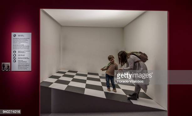 Visitors at the Museu de Arte Popular enter into an optical illusional space in the Dutch artist Maurits Cornelis Escher exhibition on March 30 2018...