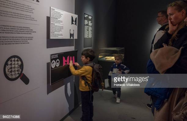 Visitors at the Museu de Arte Popular play with an interactive exercise as part of Dutch artist Maurits Cornelis Escher exhibition on March 30 2018...