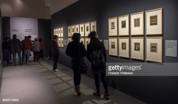 Visitors at the Museu de Arte Popular take in the work of Dutch artist Maurits Cornelis Escher on March 30 2018 in Lisbon Portugal This exhibition...