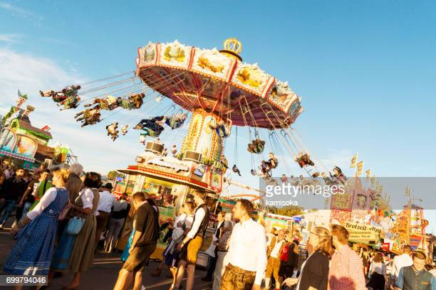 visitors at the oktoberfest fairgrounds – friendliness - theresienwiese stock pictures, royalty-free photos & images