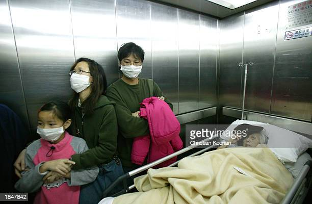 Visitors at the Prince of Wales hospital wear face masks in an effort to protect themselves from a deadly and contagious respiratory virus March 14...