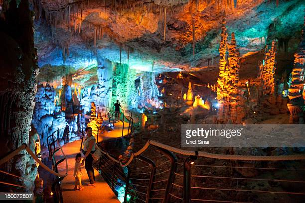 Visitors at the Sorek stalactites cave as it is illuminated with a new lighting system on August 9 2012 near Beit Shemesh Israel The cave 82 meters...