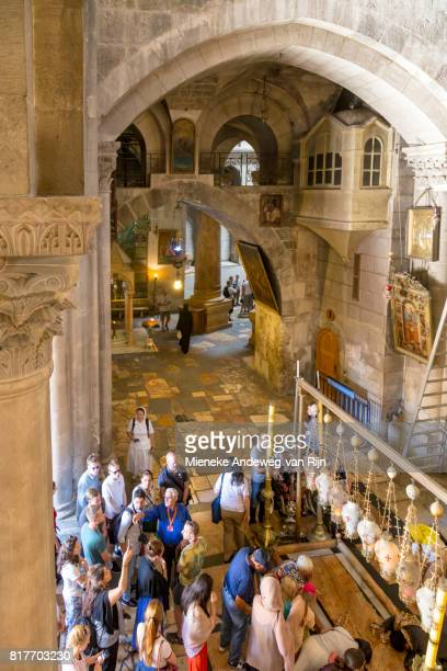 Visitors at the Stone of Unction in the Church of the Holy Sepulchre, Jerusalem, Israel.