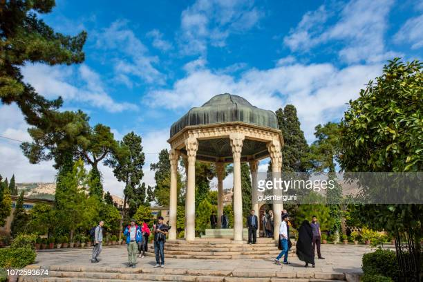 shiraz, iran - november 10, 2018: visitors at the tomb of hafez, shiraz, iran - shiraz stock pictures, royalty-free photos & images