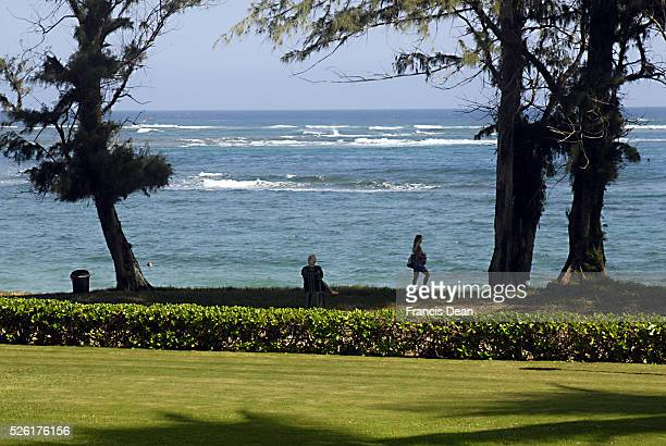 Visitors at View of Pono kai resort at Kapa'a beach park at Kauai Island on Hawaii 1 jan 2013