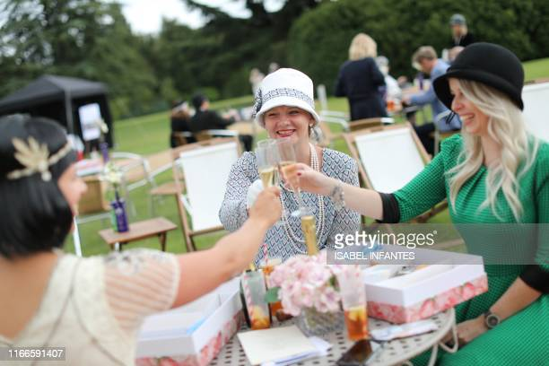Visitors attend a 1920's themed event at Highclere Castle near Newbury west of London on September 7 ahead of the world premiere of the Downton Abbey...