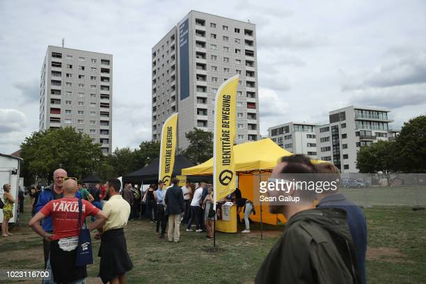 Visitors attend a gathering entitled Europa Nostra and hosted by the Identitarian Movement on August 25 2018 in Dresden Germany The Identitarian...