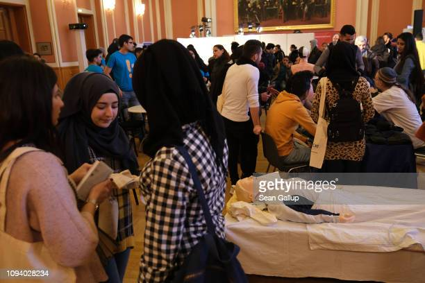 Visitors attend a jobs fair for refugees that offers training programs and jobs in the caregiving and health care industries on January 14 2019 in...