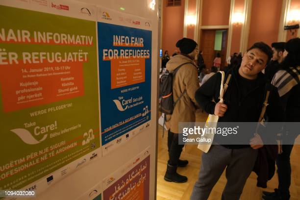 Visitors attend a jobs fair for refugees that promotes training programs and jobs in the caregiving and health care industries on January 14 2019 in...