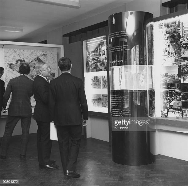 Visitors attend a press conference and exhibition at Wilton Hall Bletchley Buckinghamshire to announce the plan for the New Town of Milton Keynes...