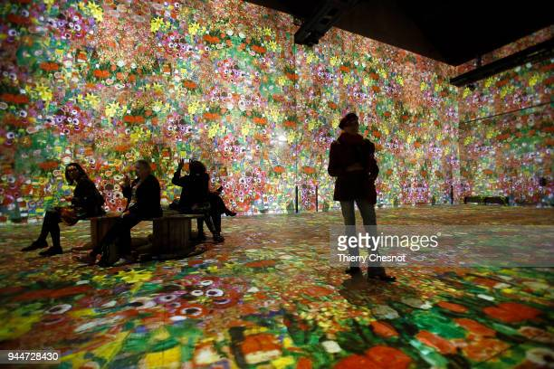 Visitors attend a press preview of the immersive exhibition Klimt Hundertwasser Poetic_Ai that pays tribute to Austrian artist Gustav Klimt at the...