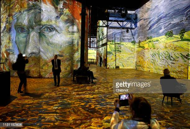 Visitors attend a press preview of the immersive exhibition Van Gogh Starry Night devoted to painter Vincent Van Gogh by multimedia artist Gianfranco...