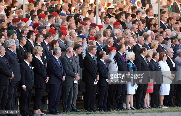 Visitors attend a swearingin ceremony for new recruits of the Bundeswehr the armed forces of the Federal Republic of Germany in front of the...