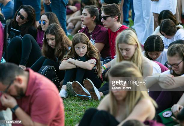 Visitors attend an interfaith ceremony to remember the 17 victims killed at the Marjory Stoneman Douglas High School shooting on the two-year...
