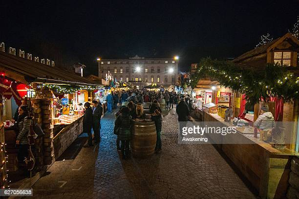 Visitors attend at the Christmas market on December 1 2016 in Trento Italy