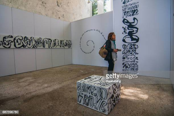 Visitors attend at the opening of the Venezuelan pavilion presenting the project 'Formas escapándose del marco' by Juan Alberto Calzadilla Álvarez at...