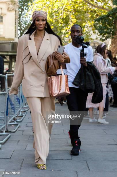 Visitors attend London Fashion Week on 13 September 2019 in London England During the fiveday event designers will showcase their Spring/Summer 2020...