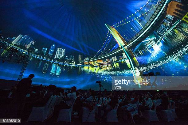 Visitors attend the 2016 International Lighting and Creative City Salon at Canton Tower during Guangzhou International Light Festival on November 22...