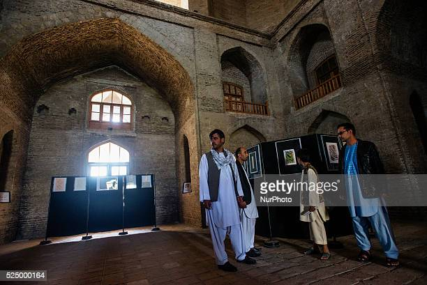 Visitors attend the Afghan calligraphy exhibition in Timur Shah Mausoleum Kabul Afghanistan