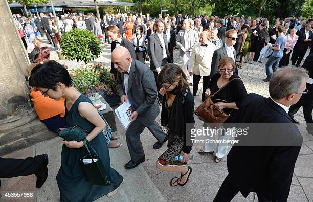 Visitors attend the Bayreuth Festival Theatre on August 12, 2014 in Bayreuth, Germany.