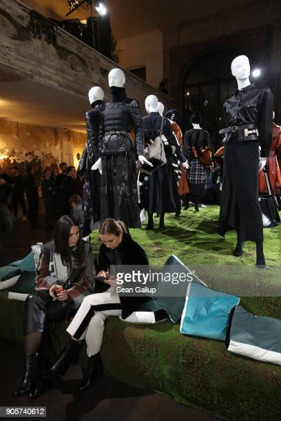 Visitors attend the Dorothee Schumacher Fashion Presentation on the first day of Berlin Fashion Week on January 16 2018 in Berlin Germany