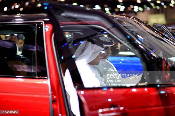 Visitors attend the Dubai Motor Show at Dubai World Trade Centre on November 15 2017 in Dubai United Arab Emirates