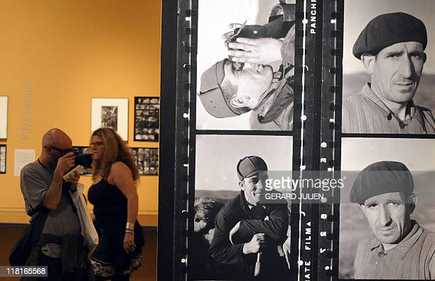 Visitors attend the exhibition 'the Mexican suitcase' in July 4 2011 during the 42nd annual Rencontres d'Arles photography festival in Arles southern...