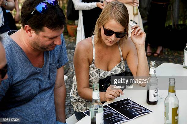 Visitors attend the EyeEm photofestival at Heimathafen Neukoelln on August 27 2016 in Berlin Germany