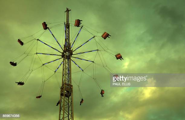 TOPSHOT Visitors attend the 'Hull Fair' one of Europe's largest annual travelling fairs in Hull north east England on October 9 2017 Showmen and...