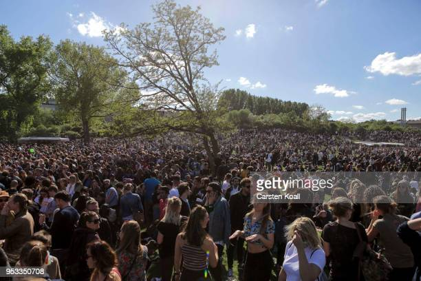 Visitors attend the Mai Goerli fest in Goerlitzer Park in Kreuzberg district on May Day on May 1 2018 in Berlin Germany May Day is a holiday in...