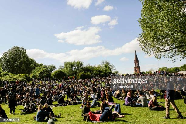 Visitors attend the 'Mai Goerli' fest in Goerlitzer Park in Kreuzberg district on May Day on May 1 2018 in Berlin Germany May Day is a holiday in...